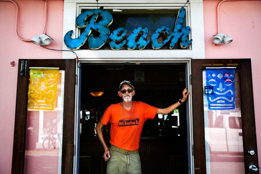 801 Bourbon Bar CFO Donnie Burgdorfer standing in a doorway under a large sign that says Beach.