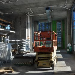 The lounge will have glass walls that slide open to the pool deck.