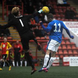 Liam Burt is beaten to the ball by Partick's keeper in Rangers' 3-2 win<br>