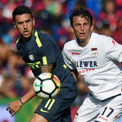 Matias Vecino (L) of Internazionale and Ante Budimir of Crotone compete for the ball in action during the Serie A match between FC Crotone and FC Internazionale at Stadio Comunale Ezio Scida on September 16, 2017 in Crotone, Italy.