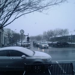 The snow started innocently around lunchtime on a Tuesday. Here, the wintry scene begins in downtown Norcross.