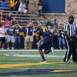 Kahlil Robinson stops the first Eastern Michigan desperation drive.<br>