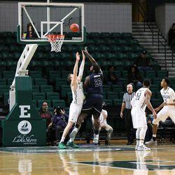 Isaiah Johnson skyhooks around the Eastern Michigan defender
