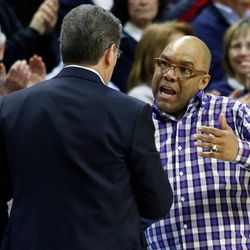 UConn head coach Geno Auriemma and Syracuse head coach Quentin Hillsman embrace after the Huskies kicked the Orange's butt.<br>