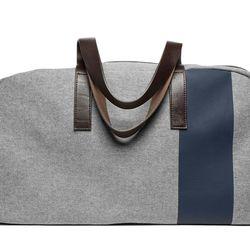 "Everlane <a href=""https://www.everlane.com/products/mens-weekender-reverse-denim-navy-stripe?collection=mens-backpacks-bags"">Twill Weekender</a>, $98"