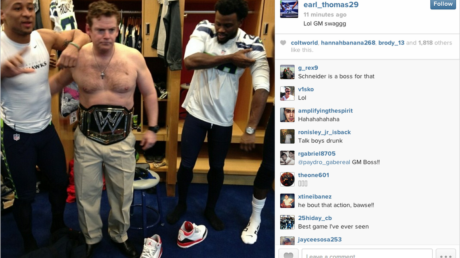 Seahawks general manager shirtless, wearing a WWE title belt ...