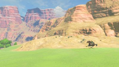 The Legend of Zelda: Breath of the Wild - Link on horseback in canyon
