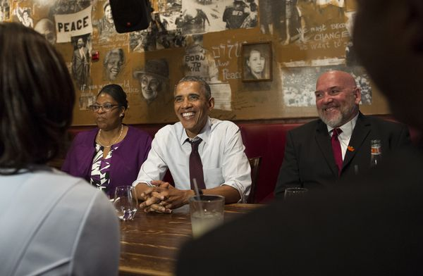 Obama with commutees Ramona Bryant and Phillip Emmert at Busboys and Poets.