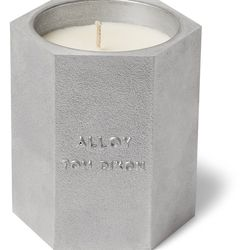 """Tom Dixon <a href=""""https://www.mrporter.com/en-us/mens/tom_dixon/alloy-scented-candle--245g/844604?ppv=2"""">Alloy Scented Candle</a>, $110"""