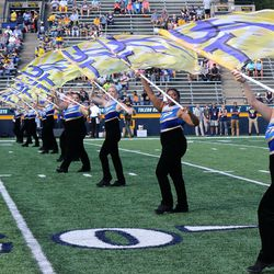 The Toledo Marching Band taking the field before the game.<br>