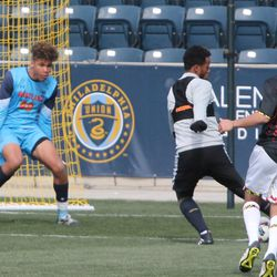 Roland Alberg delivering an assist to the far post to Charlie Davies