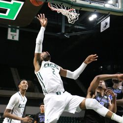 James Thompson getting fouled at the basket.
