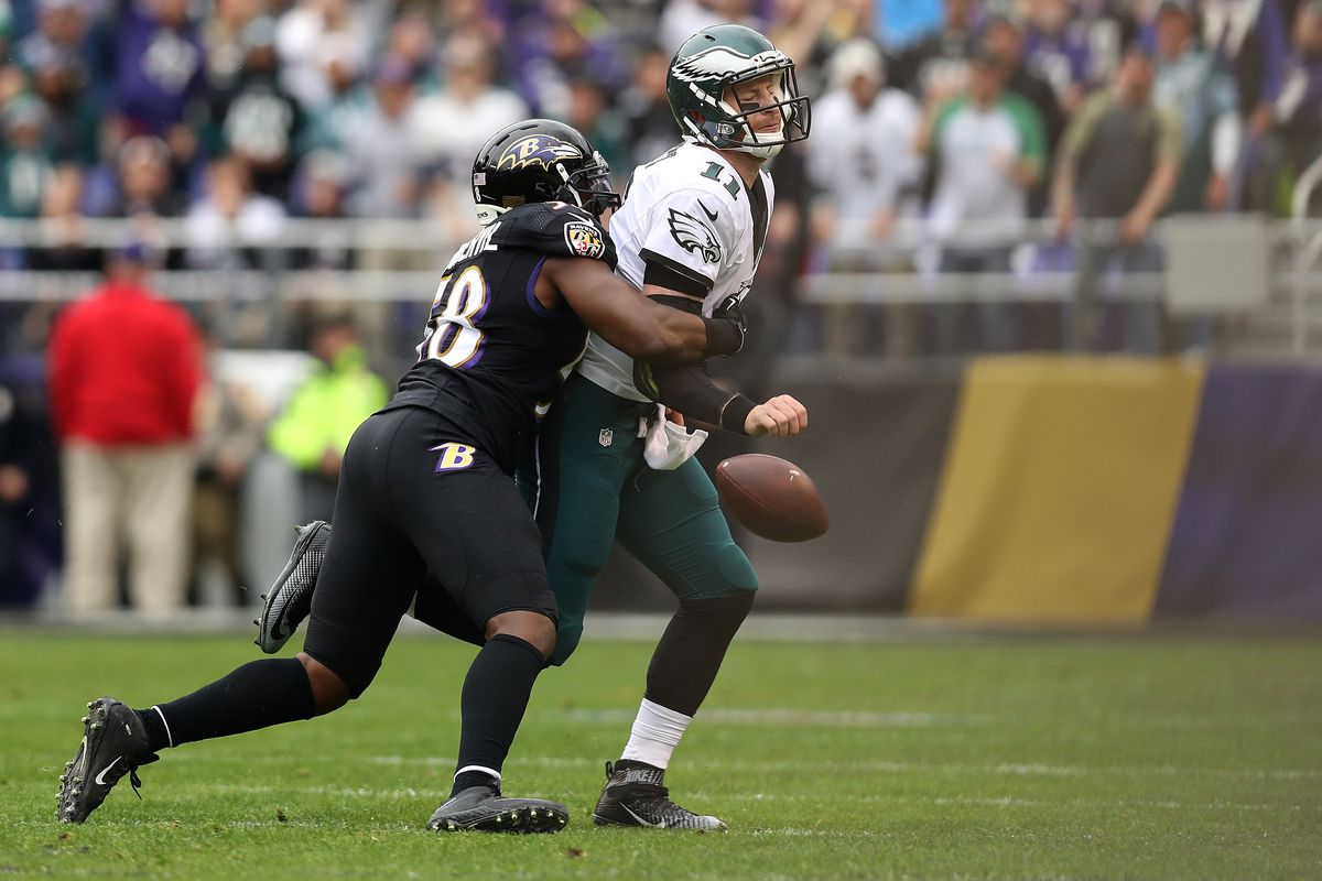 Ravens cut Elvis Dumervil, who fought injuries in 2016