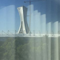 The tower from the Olympic Stadium rises above Stade Saputo on the morning of match day.