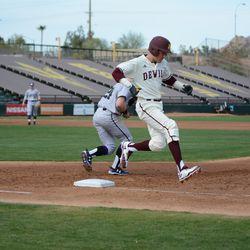 Freshman Myles Denson runs through first base