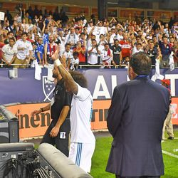 Marcelo leaving the pitch as fans cheer on.