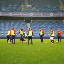 Rangers' subs warm-up during the half-time break<br>