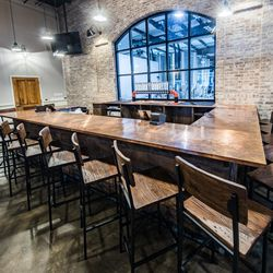 The bar is topped with copper and features large windows that look into the brewery.