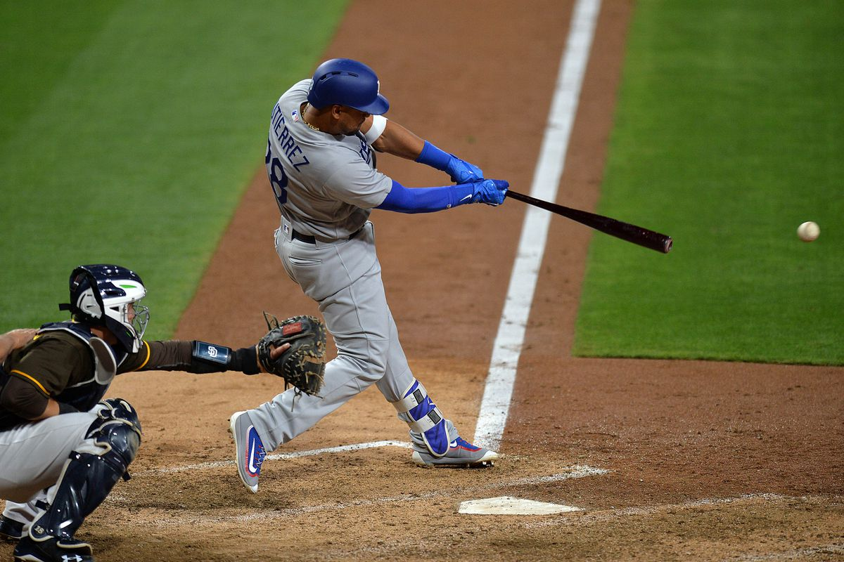 Taylor hits grand slam in first, Dodgers pound Pirates 12-1