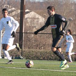 Patrick Murphy looks to send a ball into the box