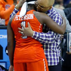 Syracuse head coach Quentin Hillsman consoles Alexis Peterson (1), who was playing in her final game with the Orange.<br>