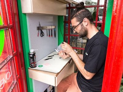 London?s iconic red phone booths reborn as tiny phone repair shops