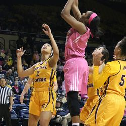 Another Toledo player putting up a basket.<br>