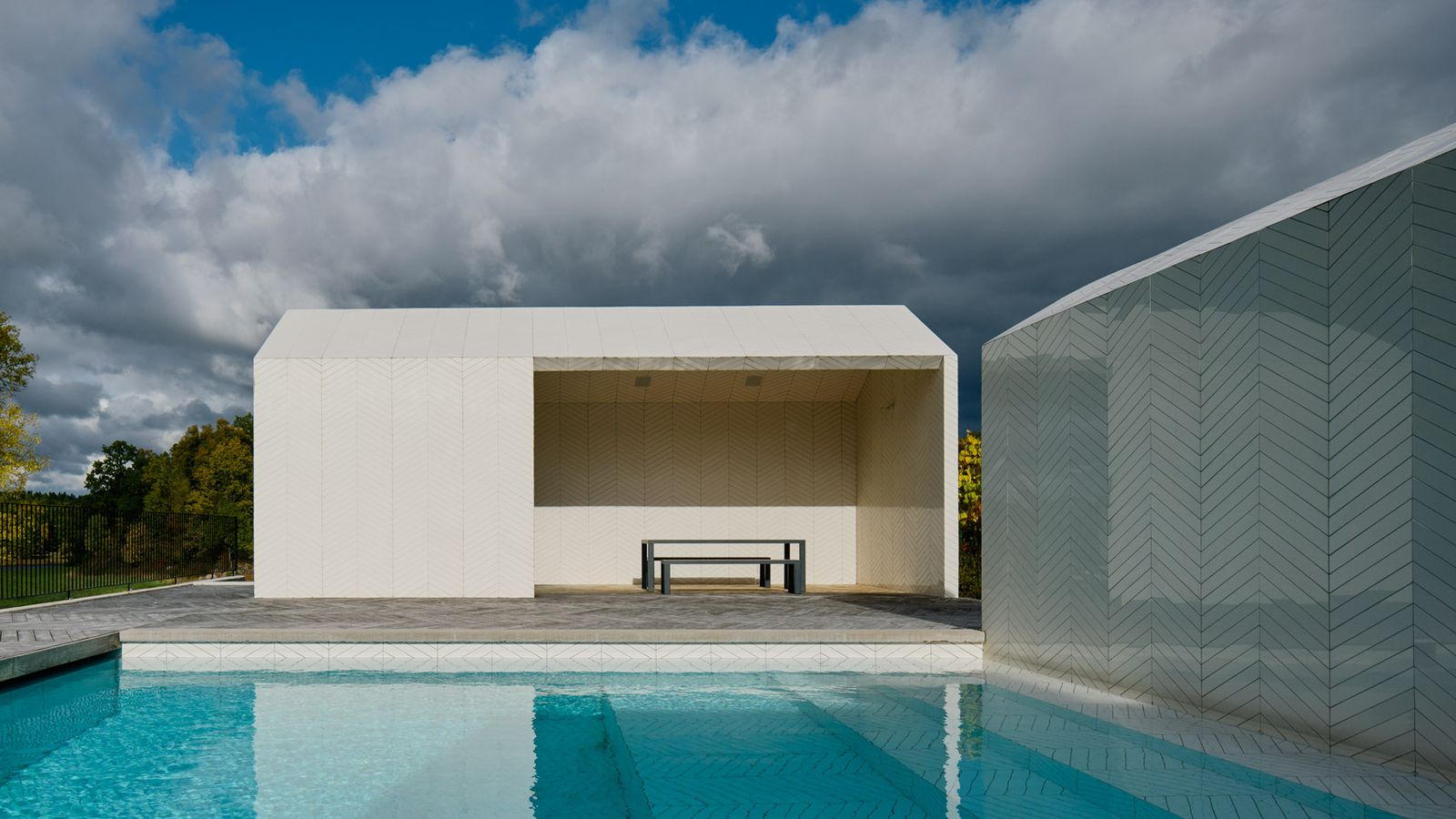 Striking swimming pool complex is clad entirely in a white for Pool design architecture
