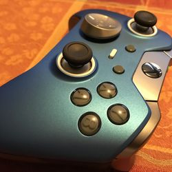 The face buttons are grey.