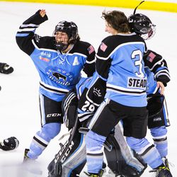The Beauts celebrate their win.