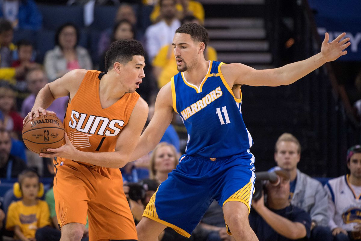 Stephen Curry scores 42, Warriors clinch West with win over Suns