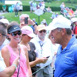 UConn women's basketball coach Geno Auriemma interacts with the crowd at the 2017 Travelers Championship Pro-Am.<br>