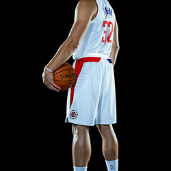 """Back view of Blake Griffin wearing the Clippers' new white """"Association edition"""" jersey."""