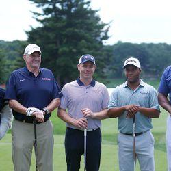 Jonathan the Husky Dog (L), Jim Calhoun (LC), Mike Cavanaugh (C), Harold Varner III (RC), Scott Burrell (R) at the 2017 Travelers Championship Pro-Am.<br>