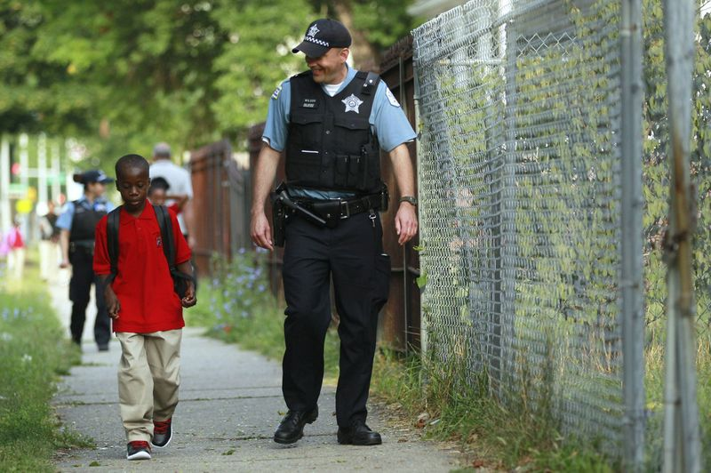 police escorting kids to school in chicago