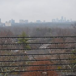 Icicles forming in Midtown, with the Buckhead skyline beyond.