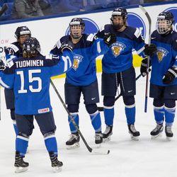 Team Finland celebrates a goal.