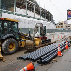 Equipment parked in front of Sports World Chicago, along Addison Street