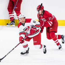 Nick Schilkey looks for a linemate as Ville Rasanen chases him down. July 1, 2017. Carolina Hurricanes Summerfest and Development Camp, PNC Arena, Raleigh, NC. Copyright © 2017 Jamie Kellner. All Rights Reserved.
