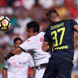 Ante Budimir (L) of Crotone and Milan Skriniar of Inter compete for a header during the Serie A match between FC Crotone and FC Internazionale at Stadio Comunale Ezio Scida on September 16, 2017 in Crotone, Italy.