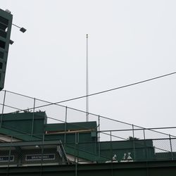 New flag poles mounted along the sides of the upper center field bleachers. This is on the Waveland Avenue side