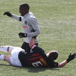 George Campbell and Fafa Picault get tangled up