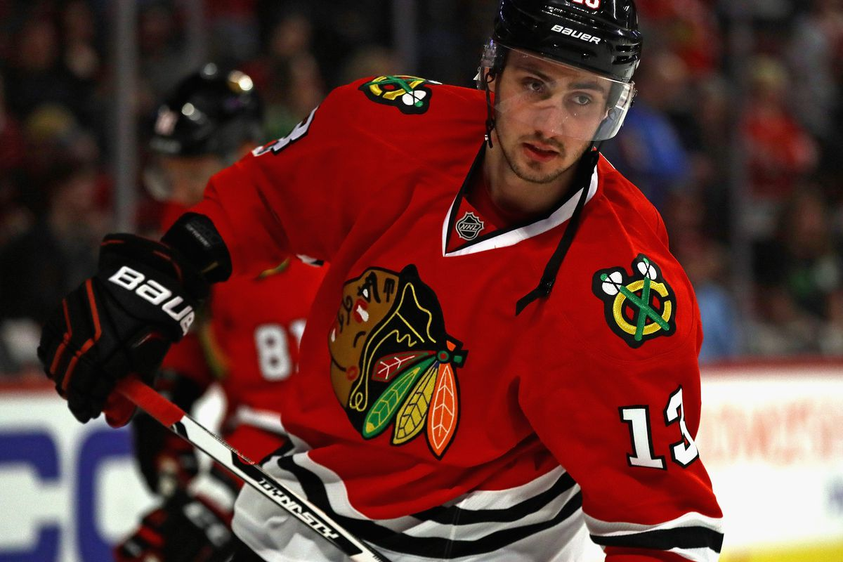 Blackhawks fall to Red Wings; Bulls routed by Rockets