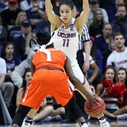 UConn's Kia Nurse (11) defends Syracuse's Alexis Peterson (1)