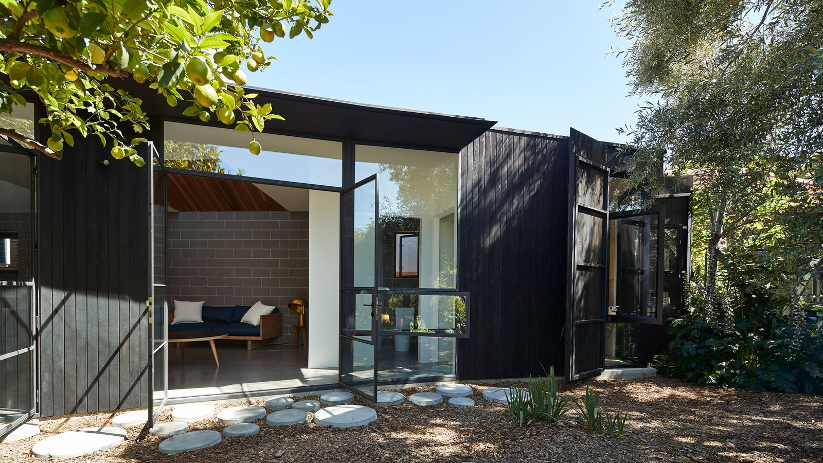 Dark timber house offers refuge for homeowner with sleep for Architectural houses for sale