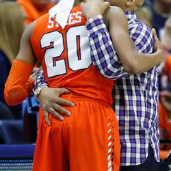 Syracuse head coach Quentin Hillsman consoles Brittney Sykes (20), who was playing in her final game with the Orange.<br>