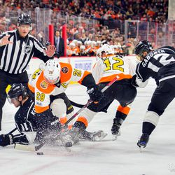 Giroux takes down Kopitar to win the face off