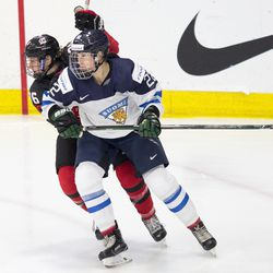 Team Finland forward Emma Nuutinen and Team Canada forward Emily Clark battle during the first semi-final game at Worlds 2017.