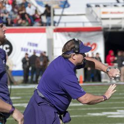 Jason Phillips and Gary Patterson relay the calls to the defense.