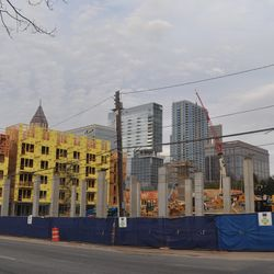 Construction progressing on the Centennial Olympic Park Drive side of the building, facing the World of Coca-Cola and Center for Civil and Human Rights.